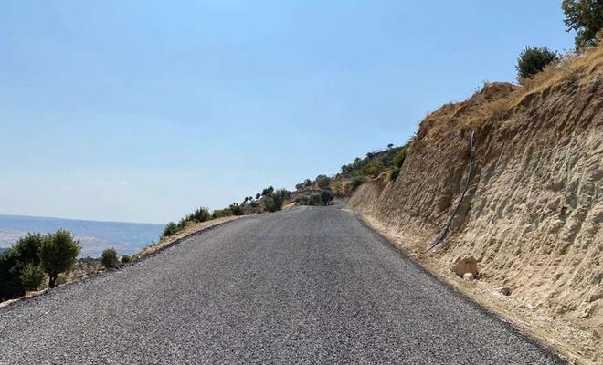 Çermik'in kırsal mahallelerinde yapımı devam eden yolun 8 kilometresi hizmete açıldı