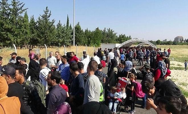 Ülkesine dönen Suriyelilere para desteği