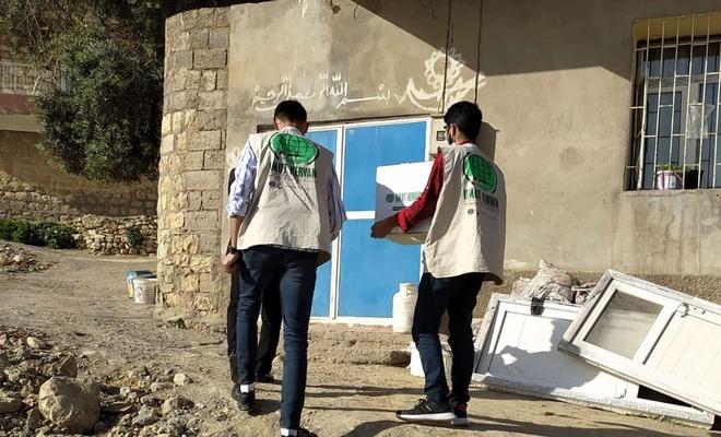 Umut Kervanı Yeşilli'de onlarca yetim ve muhtaç aileye ramazan yardımı dağıttı