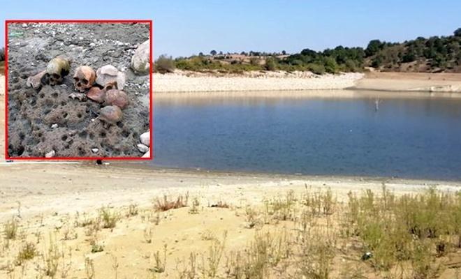 Sulama göletindeki suyun çekilmesiyle ortaya çıkan kafatası ve kemikler, tedirgin etti