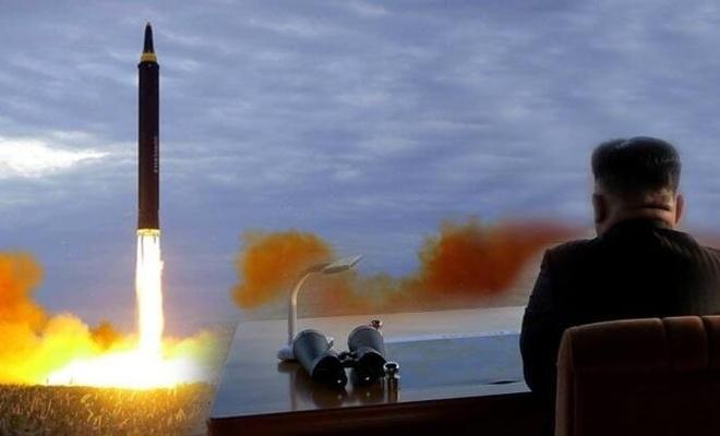 Kim Jong yine aynı, gövde gösterisi yaptı nükleer silahları işaret etti