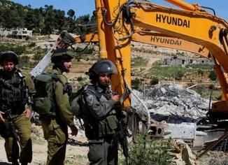 İşgal rejimi Filistinlilerin evlerini ve iş yerlerini çeşitli bahanelerle yıkıyor